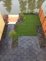 Damwand in tuin in Delft